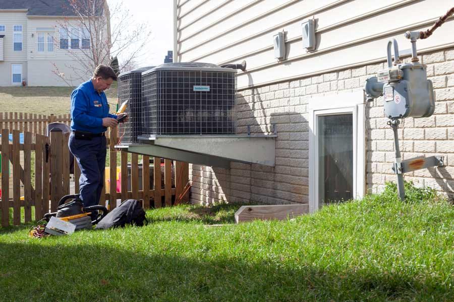 Nelson Revollo diagnosing and servicing HVAC unit