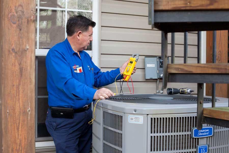 Nelson servicing HVAC unit
